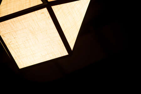 darkroom: Electric lamps hanging on the ceiling in dinner time. Stock Photo