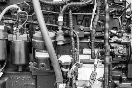 Sluggish engine and oil stains of used cars in black and white colour. Stock Photo