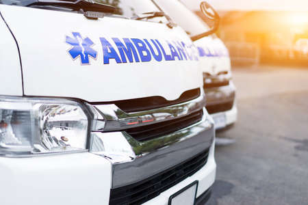 Ambulance blue parked together to provide assistance to patients.