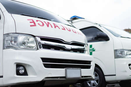 Two Ambulance with patient care in the hospital. Фото со стока