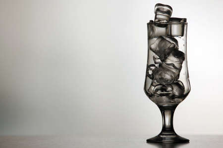 Detail of a glass filled with ice on a light background Stock Photo - 9340757