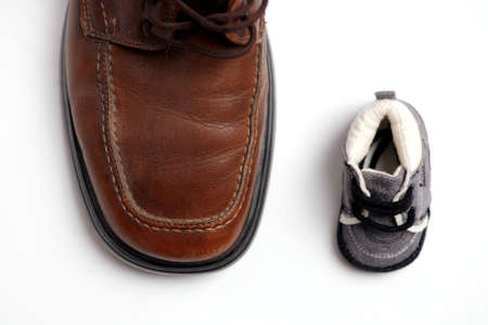 big and small: Two shoes, big and small, father and son Stock Photo