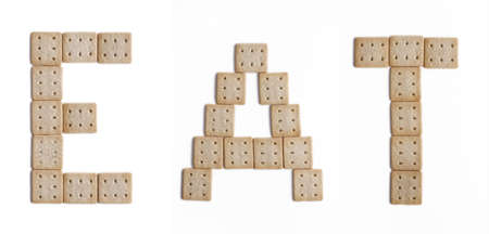 The word EAT written with biscuit fonts photo