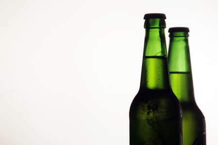 Two beer bottles on a white background photo