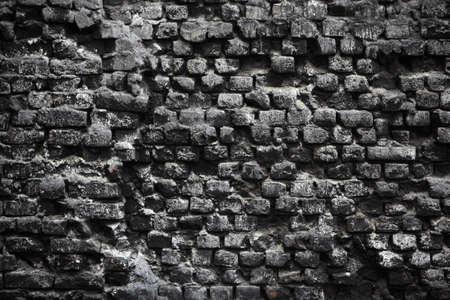 Gray texture of a burned bricks wall Stock Photo - 9385747