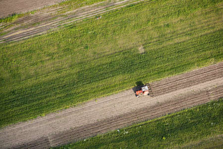 Aerial view of a tractor plowing a field photo