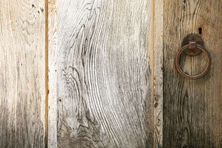 Detail with the handle of an old wooden door photo