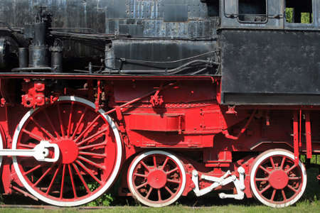 Color detail of an old steam locomotives wheels photo