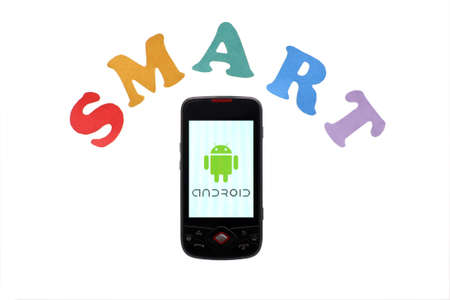 Bucharest, Romania - June 16, 2011: Close-up shot of an Android smartphone with the Android logo displayed on the screen and colored letters reading  Stock Photo - 9890798