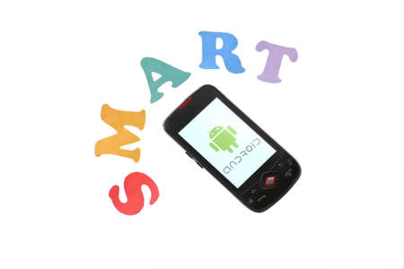 Bucharest, Romania - June 16, 2011: Close-up shot of an Android smartphone with the Android logo displayed on the screen and colored letters reading  Stock Photo - 9890795