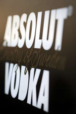 Bucharest, Romania - June 25, 2011: Close-up shot of an ad for Absolut Vodka. Absolut Vodka is a brand of vodka, produced near Ahus, Skane, in southern Sweden.
