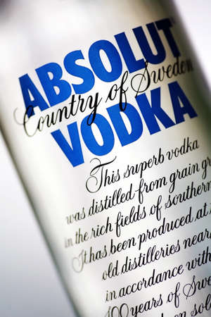 alcohol logo: Bucharest, Romania - June 25, 2011: Close-up shot of a  one liter bottle of Absolut Vodka. Absolut Vodka is a brand of vodka, produced near Ahus, Skane, in southern Sweden.
