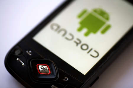 Bucharest, Romania - April 22, 2011: Close-up shot of an Android smartphone with the Android logo displayed on the screen.  Stock Photo - 10005949