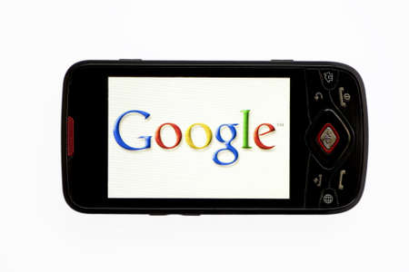 displayed: Bucharest, Romania - April 22, 2011: Close-up shot of a smartphone with the Google logo displayed on the screen.  Editorial