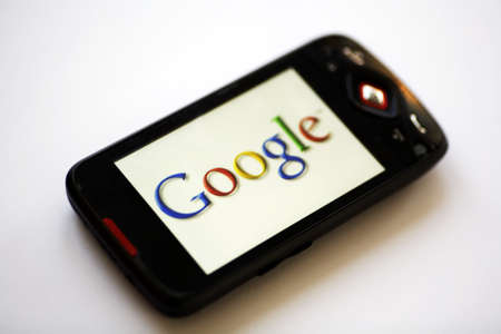 Bucharest, Romania - April 22, 2011: Close-up shot of a smartphone with the Google logo displayed on the screen.  Editorial