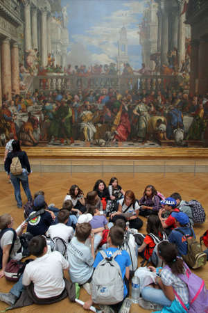 museum visit: Paris, France - May 20, 2011: Visitors look at The wedding in Cana painting at the Louvre museum in Paris, France. The Wedding at Cana is a massive painting by the late-Renaissance or Mannerist Italian painter, Paolo Veronese.