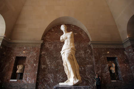 aphrodite: Paris, France - May 20, 2011: The famous sculpture of Venus is displayed at the Louvre museum in Paris, France. Aphrodite of Milos, better known as the Venus de Milo, is an ancient Greek statue and one of the most famous works of ancient Greek sculpture.