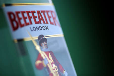 beefeater: Bucharest, Romania - July 15, 2011: Close-up shot of a one liter bottle of Beefeater gin. Beefeater Gin is a brand of gin bottled, and distributed in the United Kingdom, by the company of James Burrough. Editorial