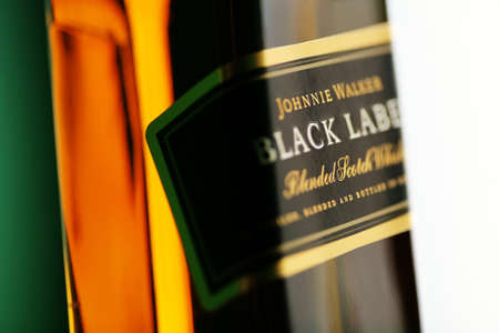 Bucharest, Romania - July 15, 2011: Close-up shot of a bottle of Johnnie Walker whiskey. Johnnie Walker is a brand of Scotch Whisky owned by Diageo and originated in Kilmarnock, Ayrshire, Scotland. Stock Photo - 10104977