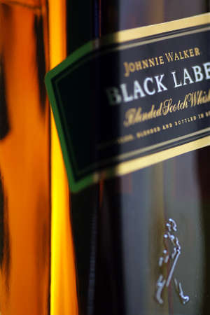 Bucharest, Romania - July 15, 2011: Close-up shot of a bottle of Johnnie Walker whiskey. Johnnie Walker is a brand of Scotch Whisky owned by Diageo and originated in Kilmarnock, Ayrshire, Scotland.