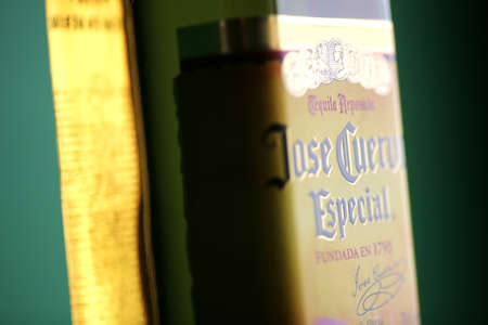 Bucharest, Romania - July 15, 2011: Close-up shot of a bottle of Jose Cuervo tequila. Jos� Cuervo is a brand of tequila produced by Tequila Cuervo La Roje�a and it has the highest sales of any tequila brand in the world. Stock Photo - 10104973