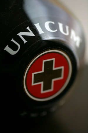Bucharest, Romania - July 15, 2011: Close-up shot of a bottle of Unicum. Unicum is a Hungarian herbal bitters, drunk as a digestif and aperitif.