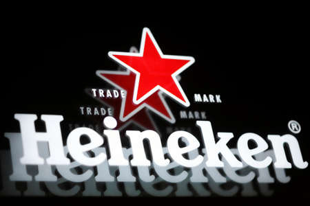 bucharest: Bucharest, Romania - July 26, 2011: Close-up shot of a Heineken beer luminous ad. Heineken is a Dutch beer which has been brewed by Heineken International since 1873. Editorial
