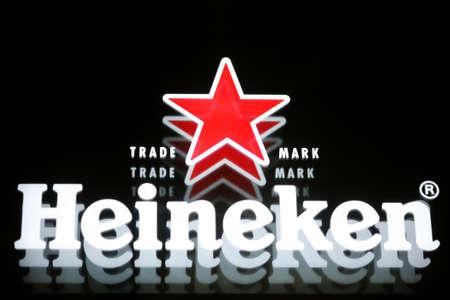 Bucharest, Romania - July 26, 2011: Close-up shot of a Heineken beer luminous ad. Heineken is a Dutch beer which has been brewed by Heineken International since 1873. Stock Photo - 10310767