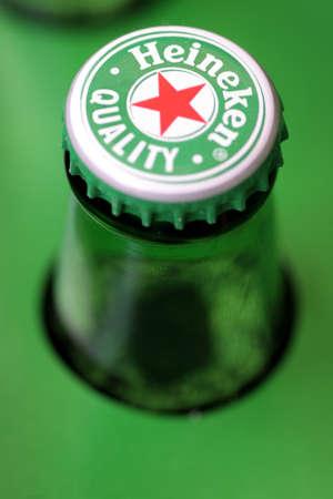 Bucharest, Romania - July 26, 2011: Close-up shot of a Heineken beer bottle cap. Heineken is a Dutch beer which has been brewed by Heineken International since 1873. Stock Photo - 10310759