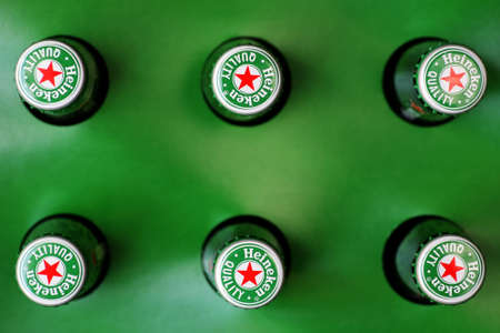 Bucharest, Romania - July 26, 2011: Heineken beer bottles pictured from above. Heineken is a Dutch beer which has been brewed by Heineken International since 1873. Stock Photo - 10310760