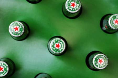 Bucharest, Romania - July 26, 2011: Heineken beer bottles pictured from above. Heineken is a Dutch beer which has been brewed by Heineken International since 1873. Stock Photo - 10310761