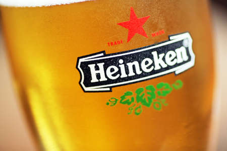 Bucharest, Romania - July 26, 2011: Close-up shot of a glass with Heineken beer. Heineken is a Dutch beer which has been brewed by Heineken International since 1873. Stock Photo - 10310769