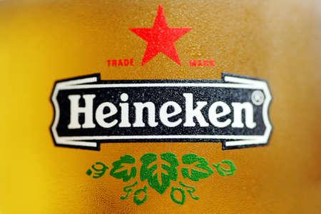 Bucharest, Romania - July 26, 2011: Close-up shot of a glass with Heineken beer. Heineken is a Dutch beer which has been brewed by Heineken International since 1873.
