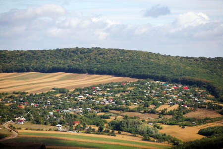 General view of a small village surrounded by hills photo