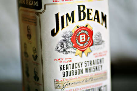 bourbon: Bucharest, Romania - October 4, 2011: Close-up shot of a bottle of Jim Beam bourbon whiskey. Jim Beam is a brand of bourbon whiskey, currently one of the best selling brands of bourbon in the world.