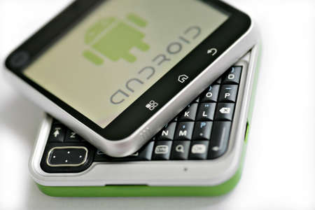 Bucharest, Romania - October 10, 2011: Close-up shot of an Android smartphone with the Android logo displayed on the screen.