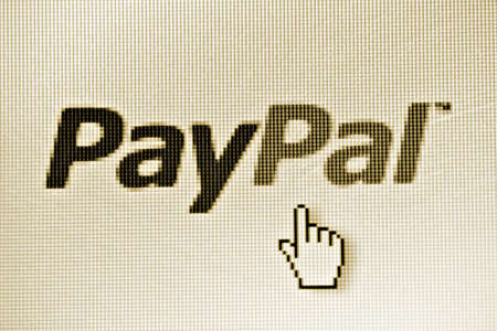 Bucharest, Romania - January 10, 2012: Close-up shot of a computer monitor displaying the PayPal logo. PayPal is an American-based global e-commerce business allowing payments and money transfers to be made through the Internet. Redakční