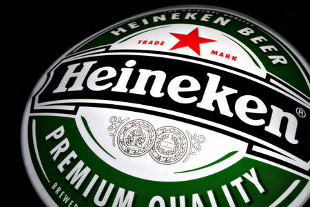 Bucharest, Romania - January 18, 2012: Color shot of a Heineken beer luminous ad. Heineken is a Dutch beer (5% abv pale lager) which has been brewed by Heineken International since 1873. Stock Photo - 12001421