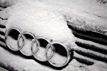 Bucharest, Romania - January 26, 2012: Picture of the the Audi logo during a snowy day. Audi AG is a German automobile manufacturer, from supermini to crossover SUVs in various body styles and price ranges that are marketed under the Audi brand, positione