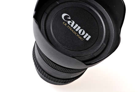 Bucharest, Romania - January 21, 2012: Studio close-up shot of a Canon Ultrasonic lenses cover. Canon Inc. is a Japanese multinational corporation that specializes in the manufacture of imaging and optical products, including cameras, camcorders, photocop