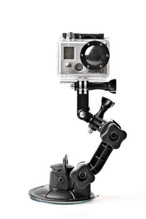 Bucharest, Romania - January 21, 2012: Close-up studio shot of a HD GoPro HERO2 action camera. GoPro is the primary brand of the privately owned Half Moon Bay, California company Woodman Labs that features small wearable waterproof and shockproof camera