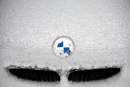 Bucharest, Romania - February 5, 2012: Picture of the BMW logo covered with ice. Founded in 1917, Bayerische Motoren Werke AG is a German automobile, motorcycle and engine manufacturing company.