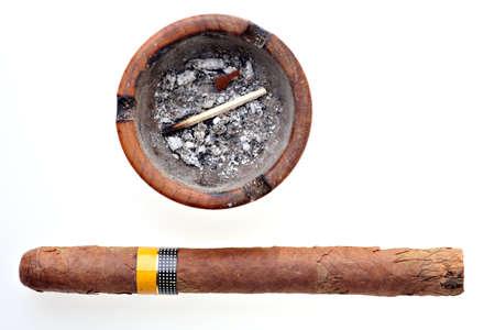 Old Cuban cigar near an ashtray isolated on white photo
