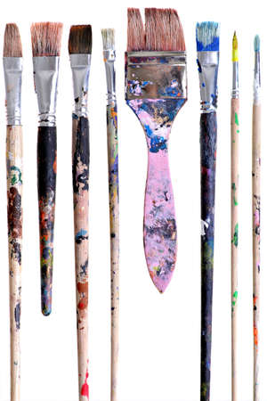 displayed: Various dirty paint brushes displayed side by side