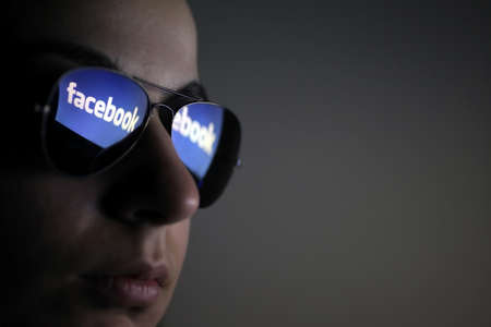 internet profile: Bucharest, Romania - March 27, 2012: Facebook logo is reflected in a pair of glasses. Facebook is a social networking service launched in February 2004, having more than 845 million active users.