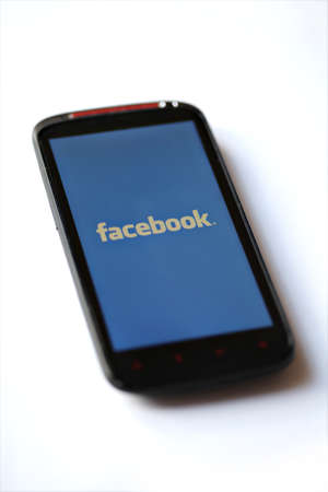 Bucharest, Romania - March 28, 2012: Facebook logo is displayed on a mobile phone screen. Facebook is a social networking service launched in February 2004, having more than 845 million active users. Stock Photo - 12993598