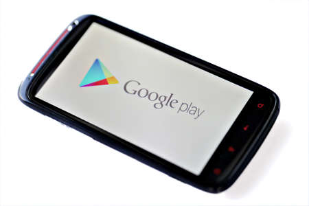 Bucharest, Romania - March 28, 2012: Google Play logo is displayed on a mobile phone screen. Google Play is a service from Google which includes an online store for music, movies, books, and Android apps and games.
