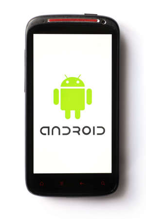 cellular phones: Bucharest, Romania - March 28, 2012: Close-up shot of an Android smartphone with the Android logo displayed on the screen. Android is a software stack for mobile devices that includes an operating system, middle-ware and key applications.