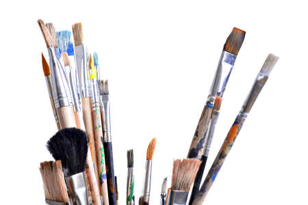 Various dirty paint brushes isolated on white