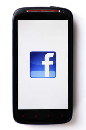Bucharest, Romania - March 28, 2012: Facebook logo is displayed on a mobile phone screen. Facebook is a social networking service launched in February 2004, having more than 845 million active users. Stock Photo - 13154952
